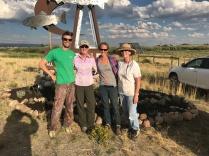 Cole Peterson, Julie Kraft, Nicole Thiele, and Dianna Trapp rest after terracing north gateway garden